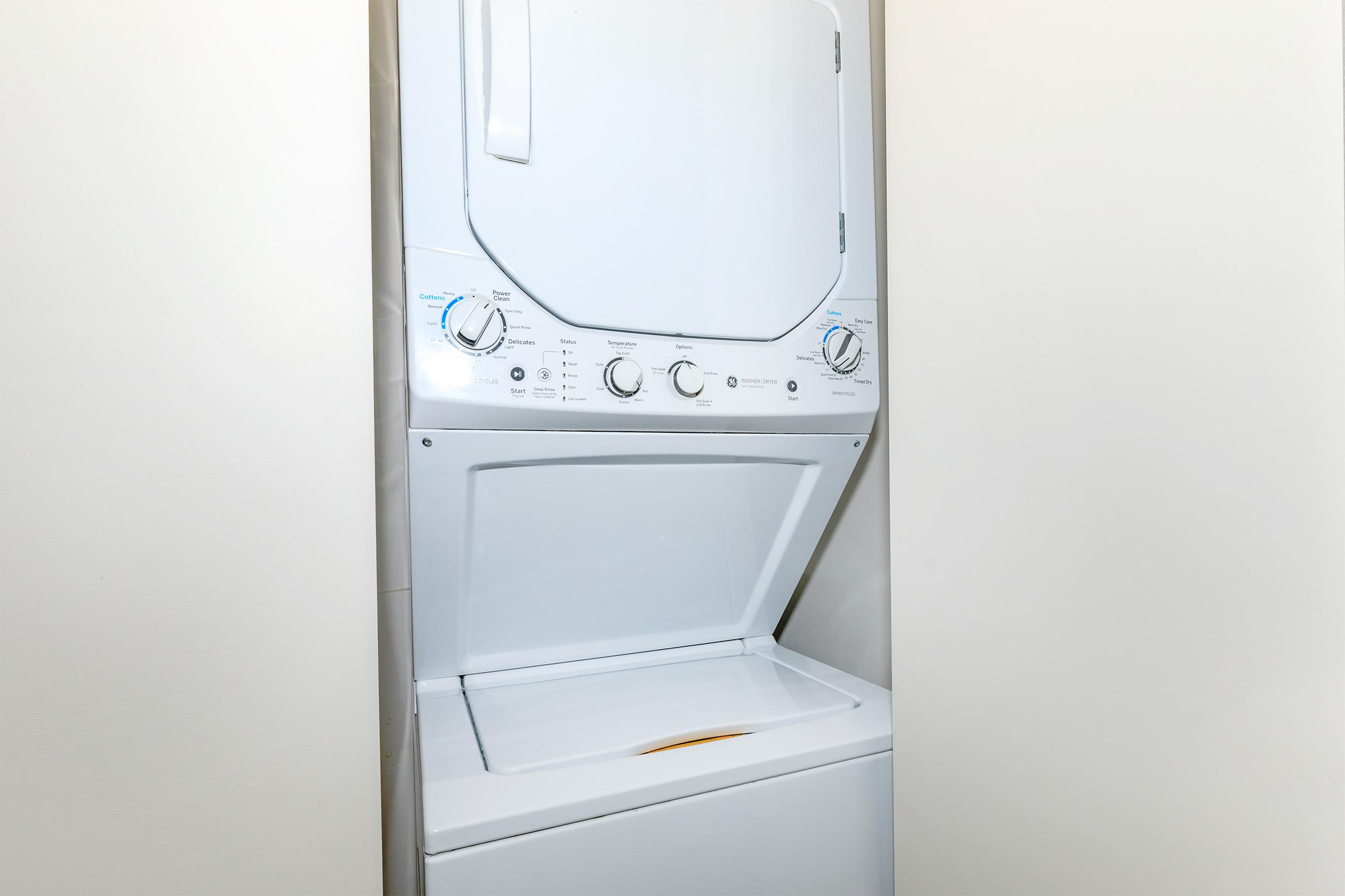 a microwave oven sitting on top of a refrigerator