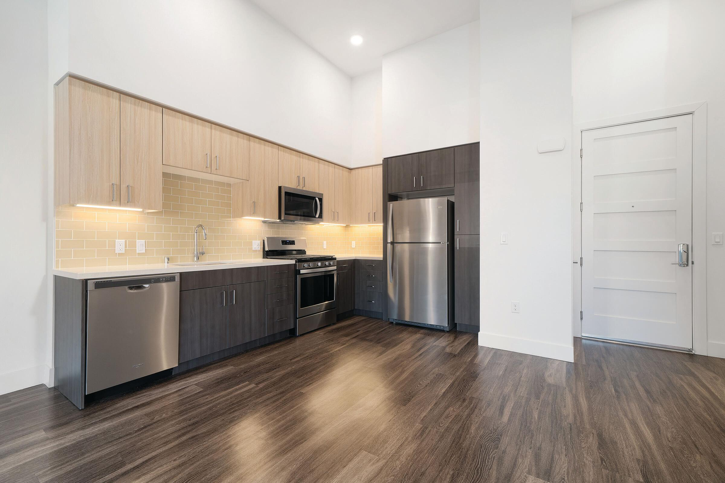 Unfurnished kitchen with stainless steel appliances