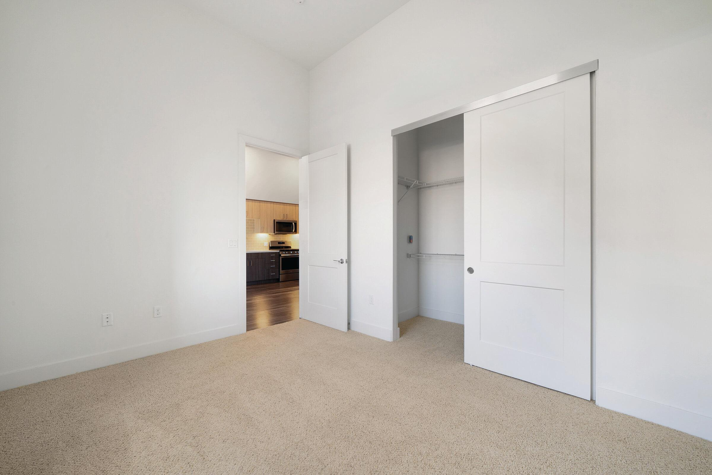 Unfurnished bedroom with open closet
