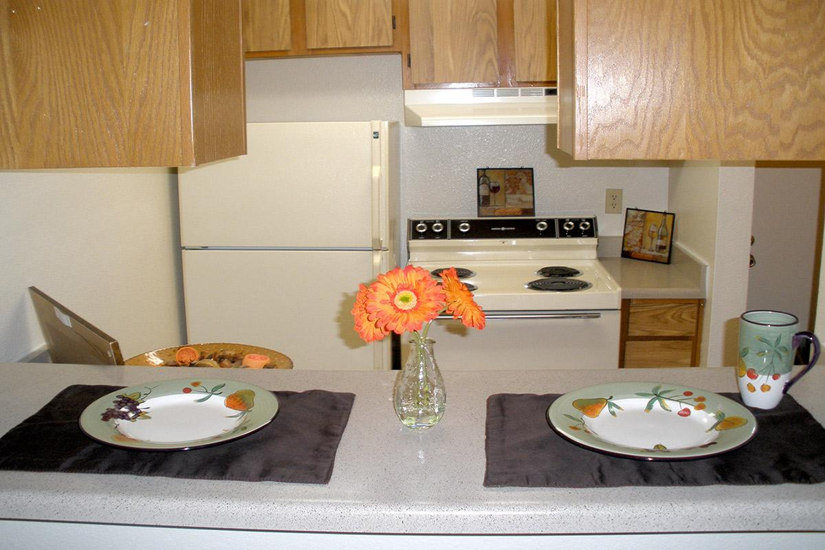 a kitchen with a plate of food on a table