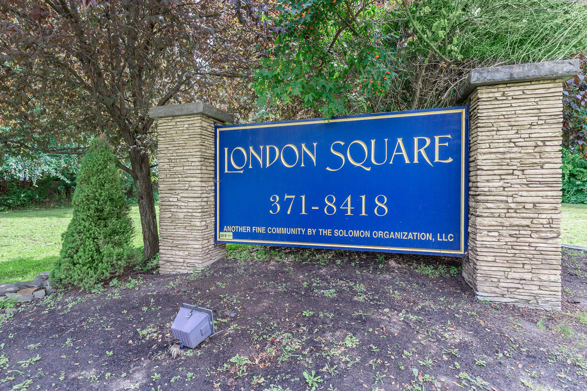 a blue sign in front of a house