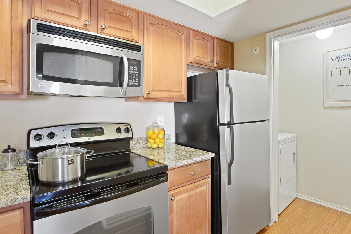 a kitchen with a stove top oven sitting inside of a microwave