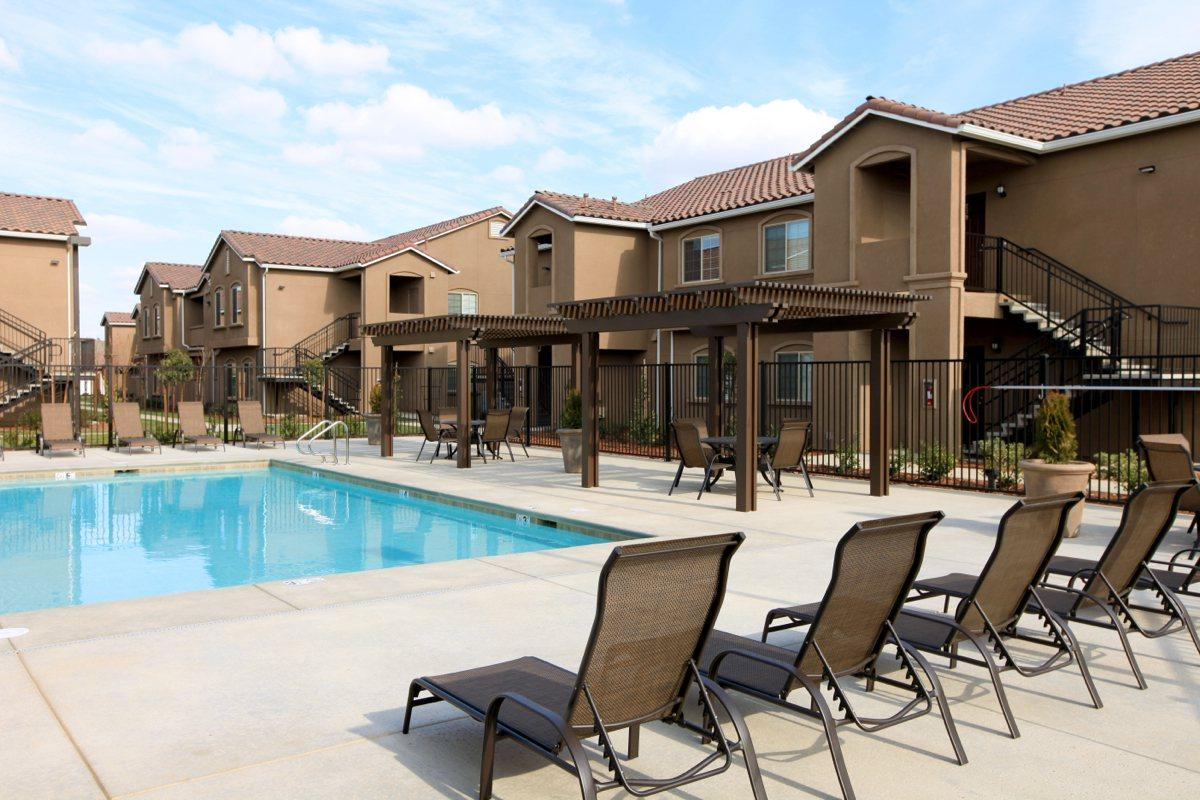 Soak in the sun on our pool deck at Greystone Apartments
