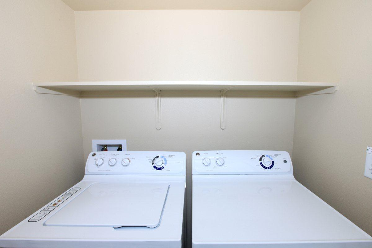 Washer-dryer in home at Greystone Apartments