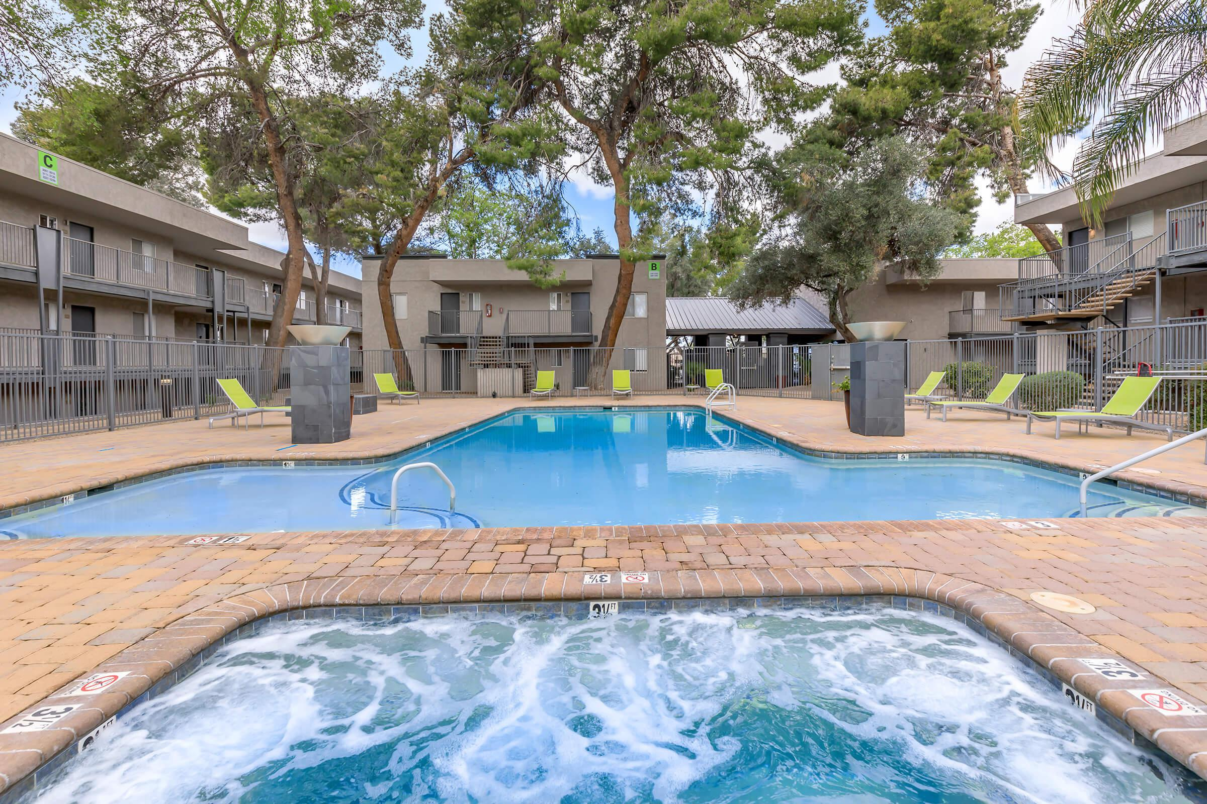 RELAX IN THE SOOTHING SPA AND SHIMMERING SWIMMING POOL