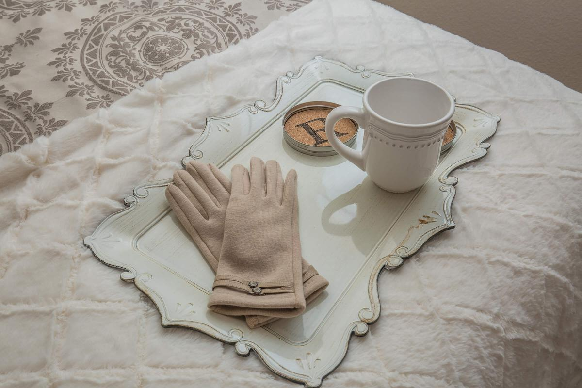 a cup of tea on a bed