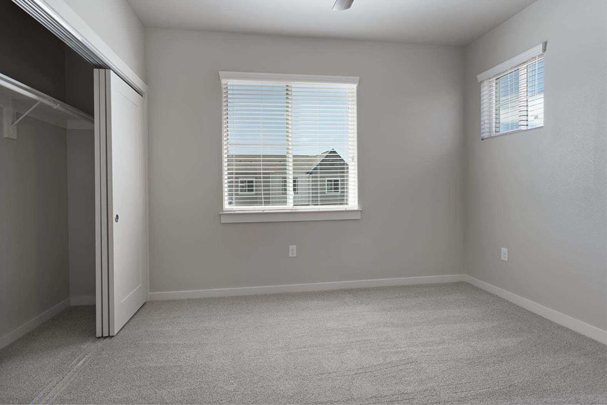 a large empty room with a sink and a window
