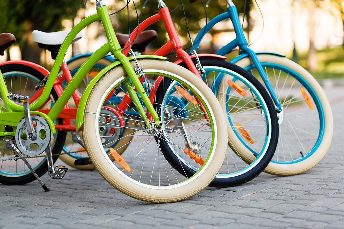 a bicycle is parked next to a basket