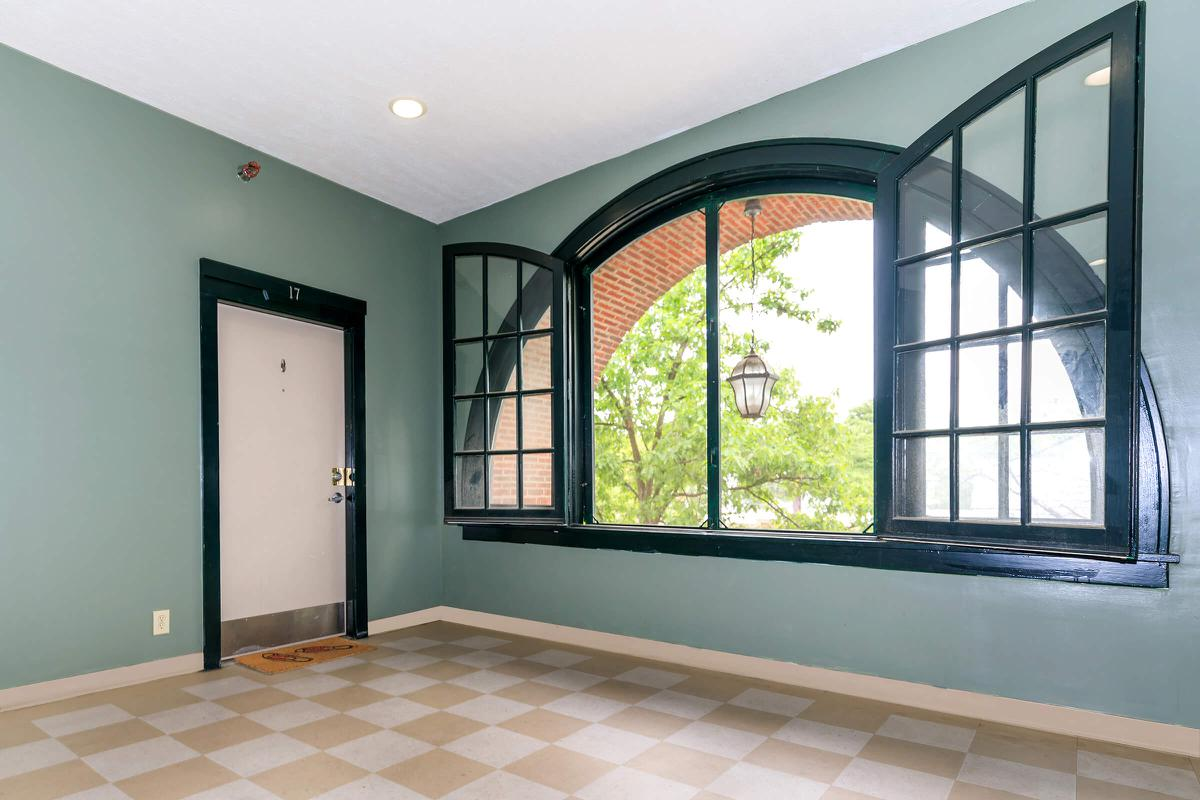 a green tiled wall and a window