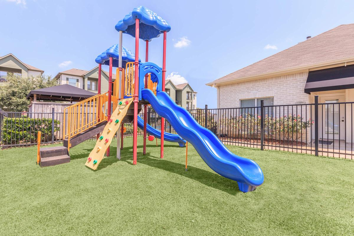 Children's play area with blue slide at The Avenue apartments