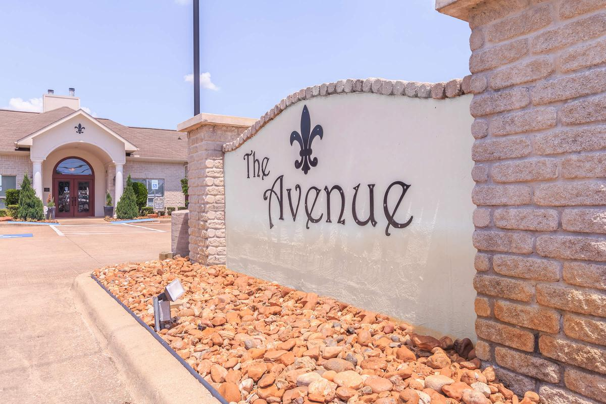 Entrance sign to The Avenue apartments in Nederland, TX