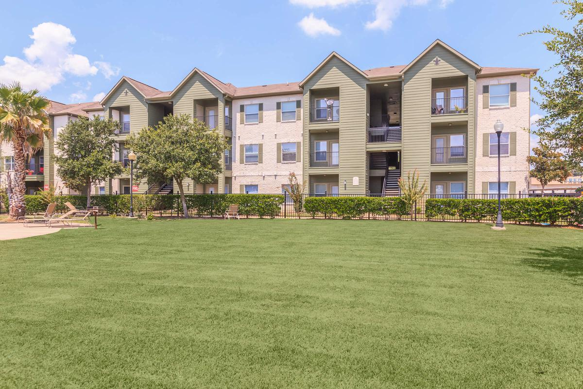 Exterior view of residential buildings at The Avenue apartments in Nederland, TX