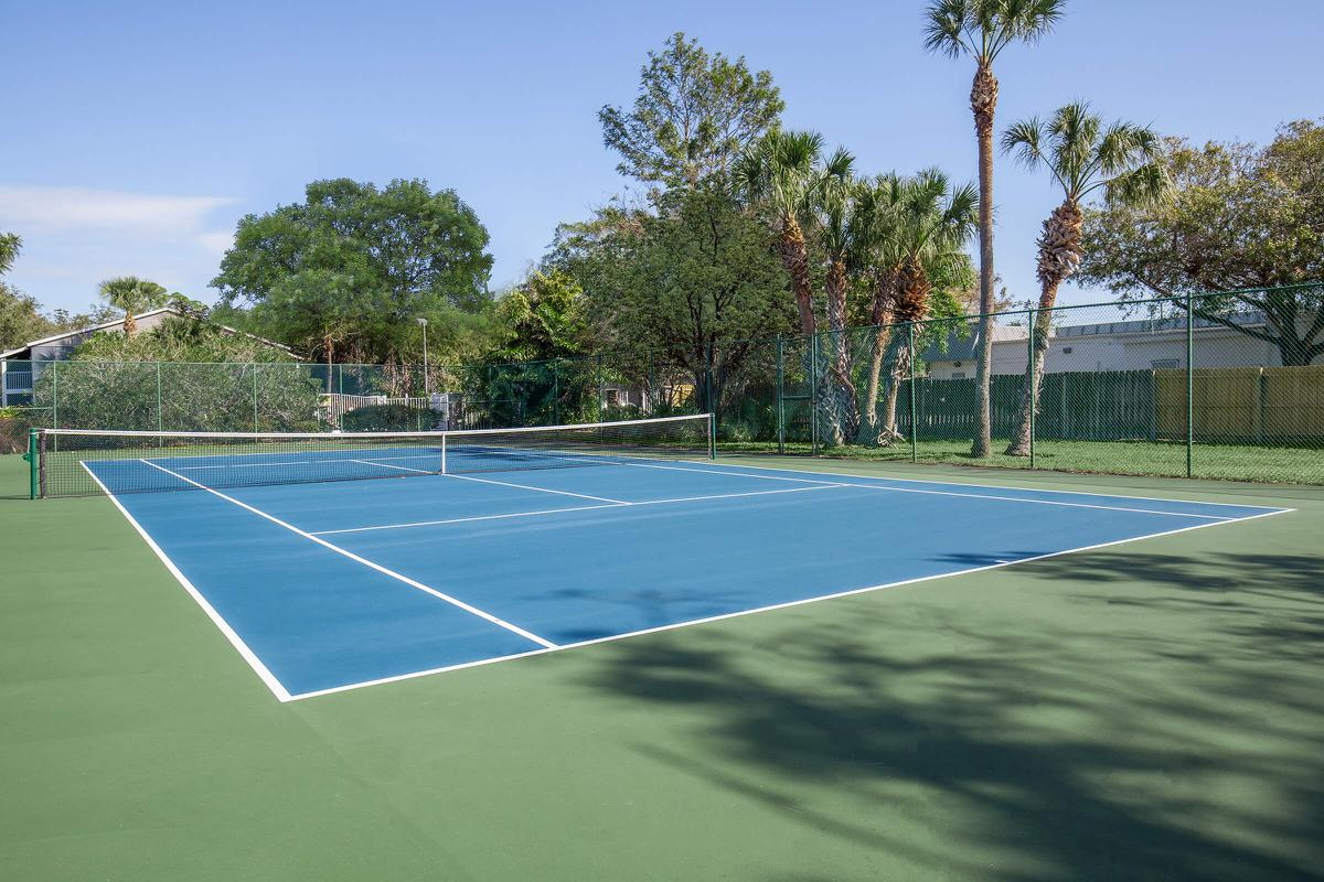 Exercise at the tennis court at Arbor Oaks Apartments in Bradenton, Florida.