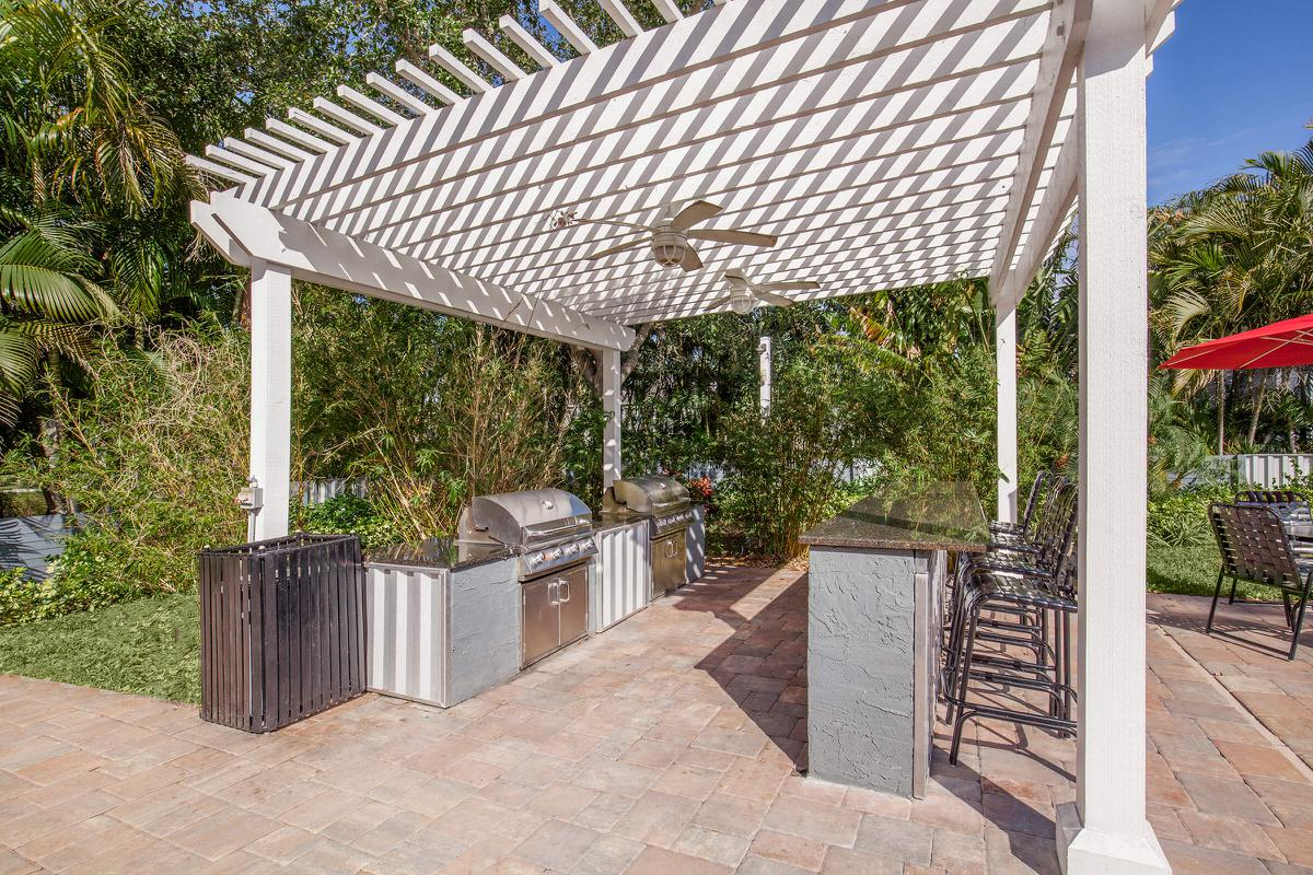 Grill up some lunch in the picnic area at Arbor Oaks Apartments in Bradenton, Florida.