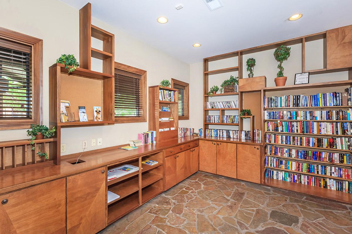 a room with a book shelf