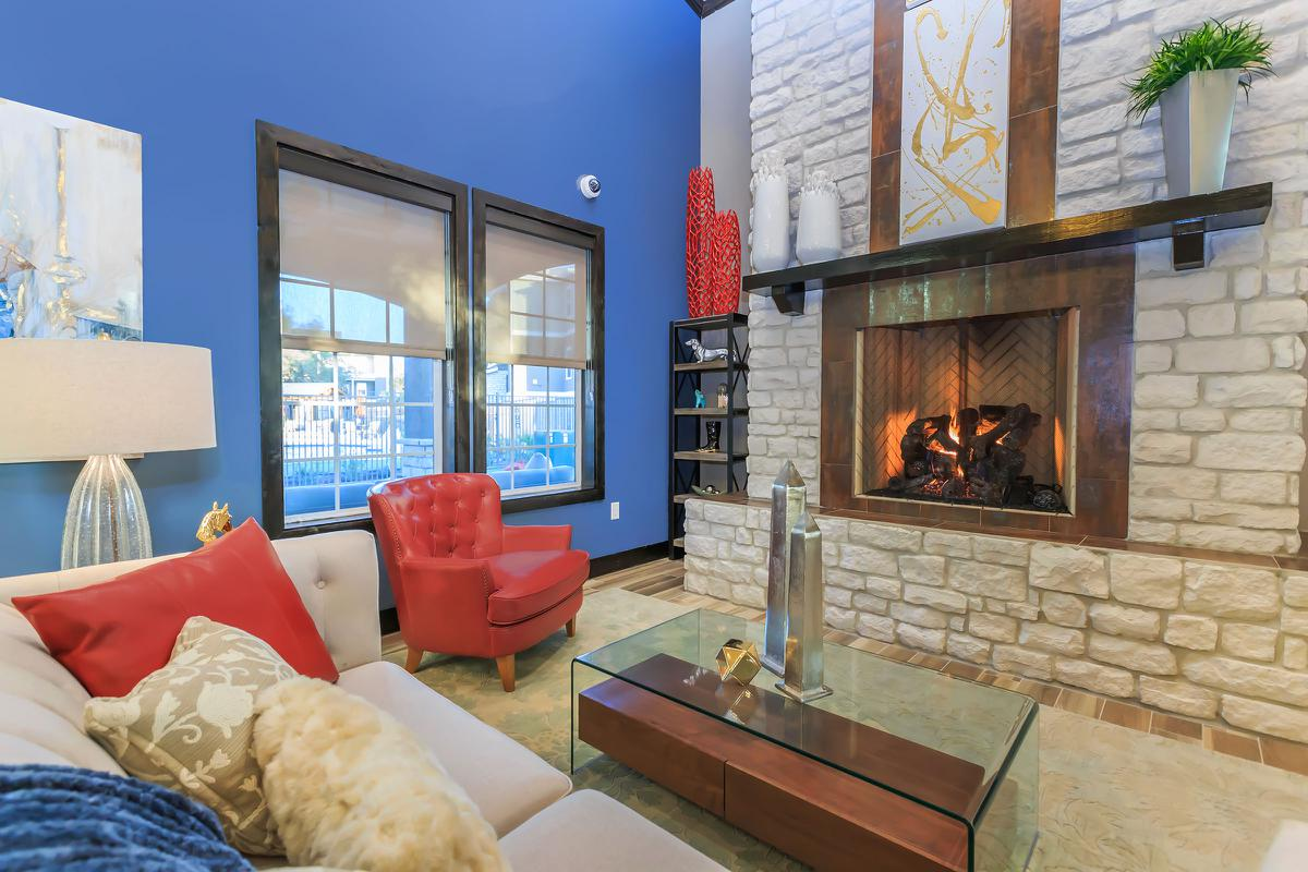 a fire place sitting in a living room with a bed and a fireplace