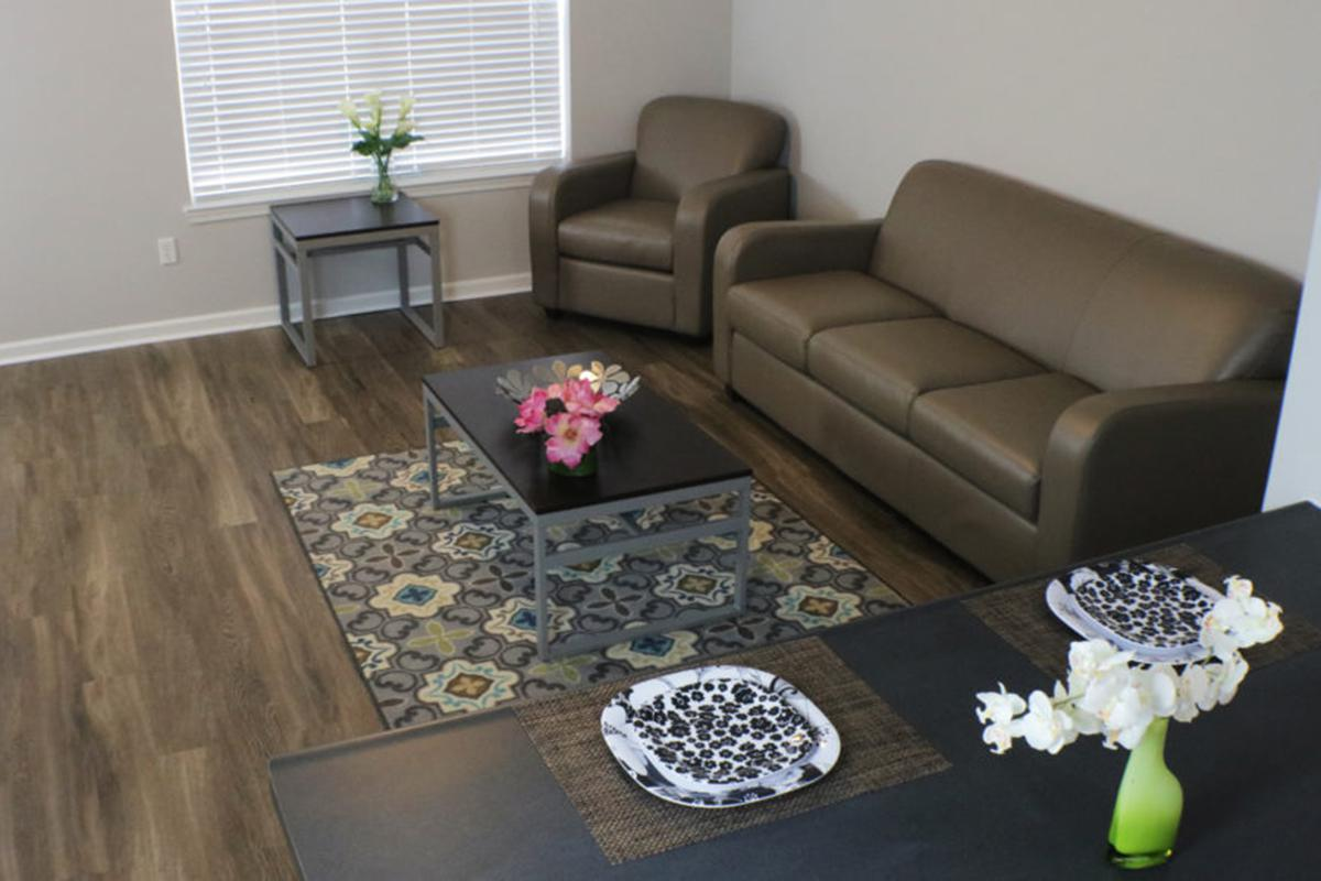 a living room filled with furniture and a coffee table