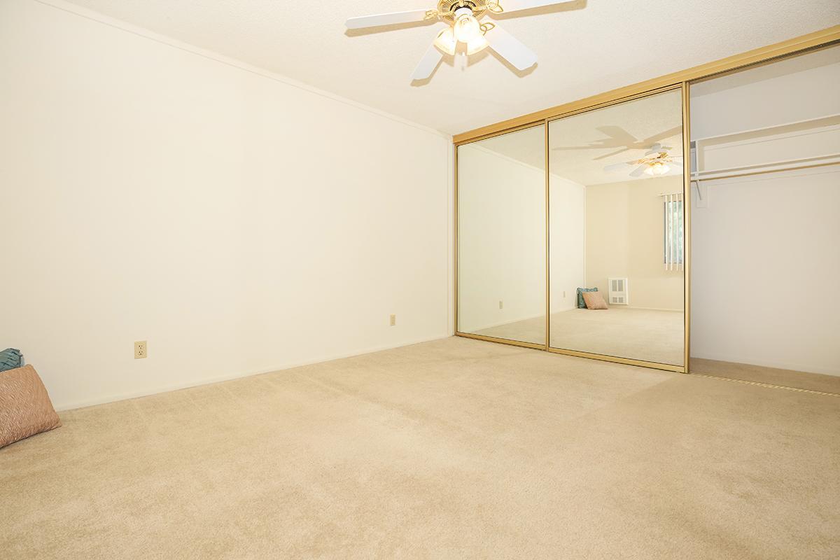 Bedroom with sliding glass closet doors