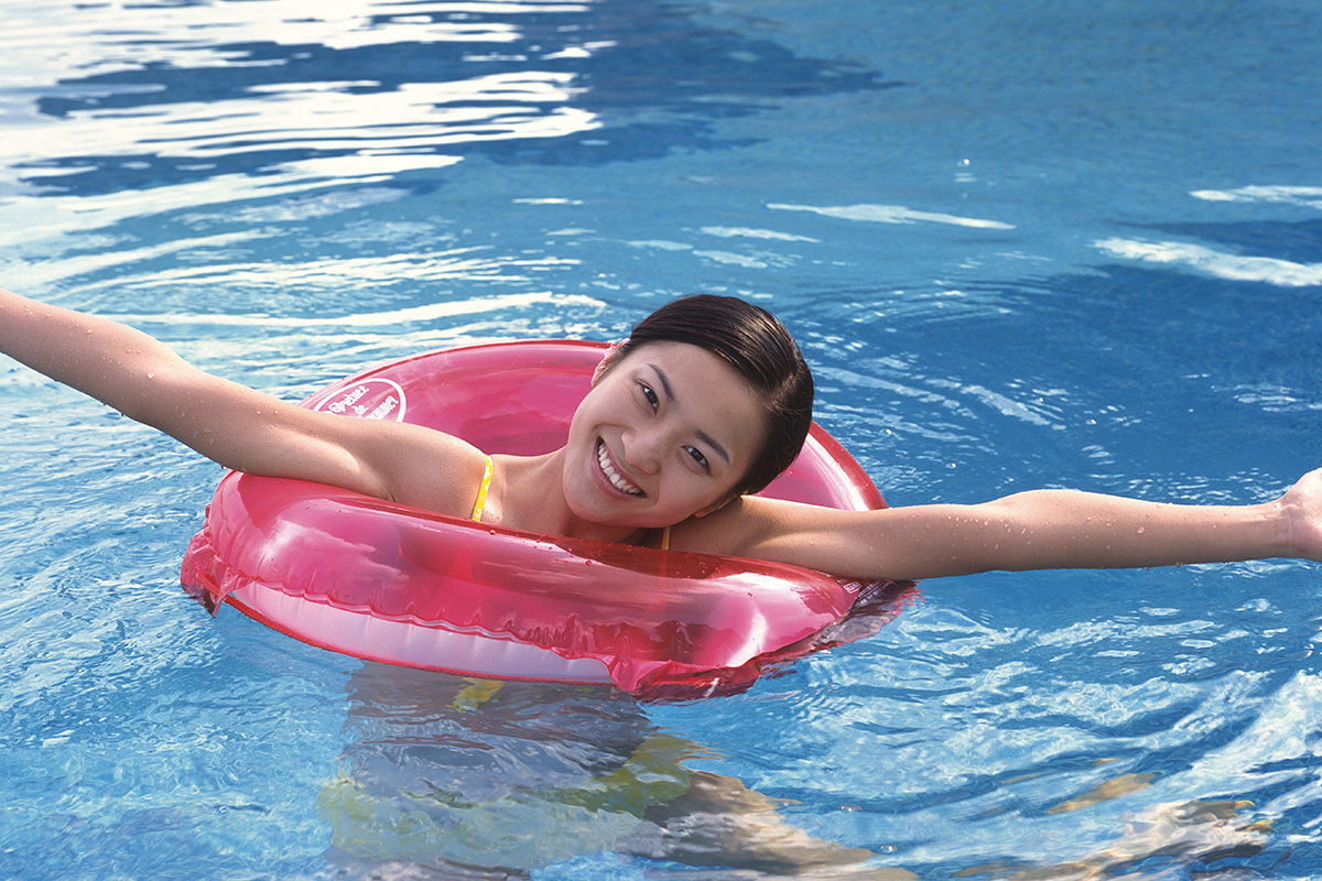 a young girl lying in a pool of water