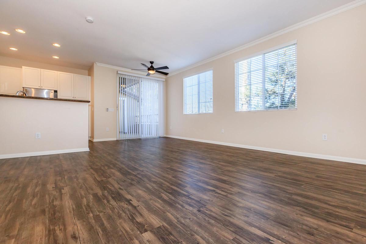 a large empty room with a wood floor