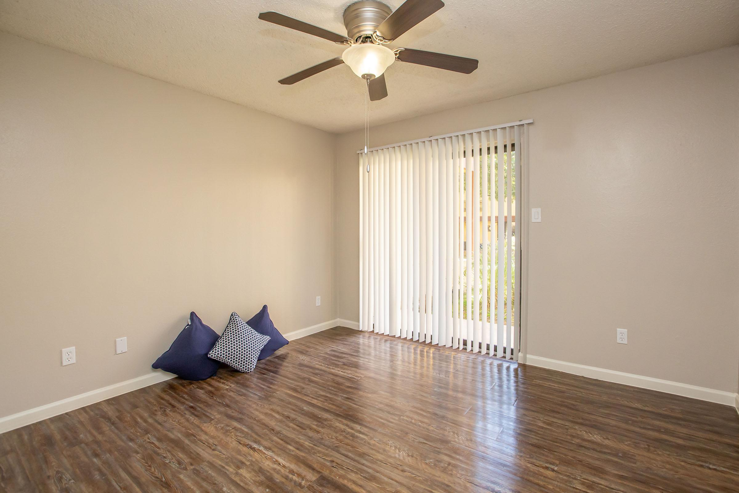 a living room with a wooden floor