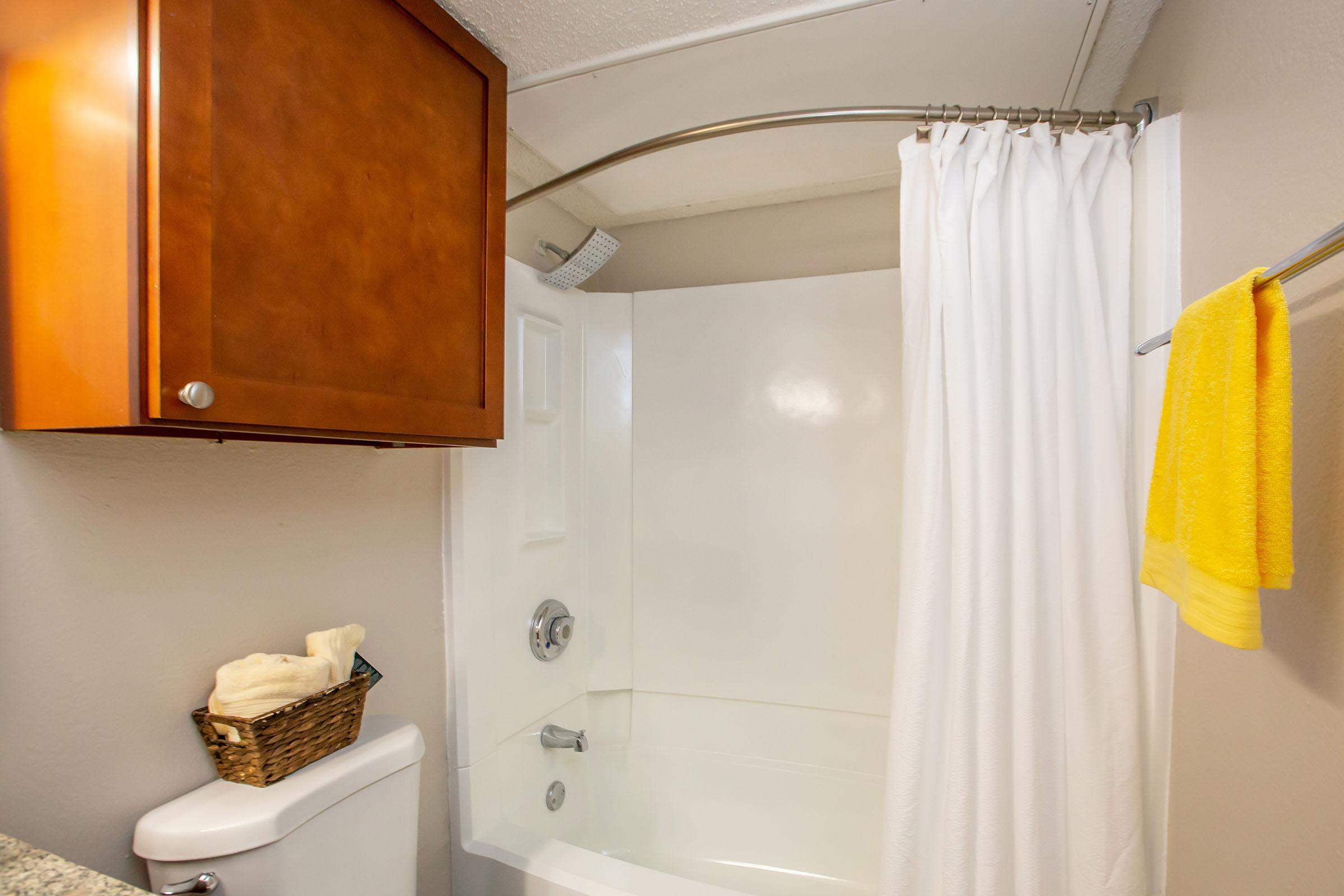 a shower with a towel hanging on the wall