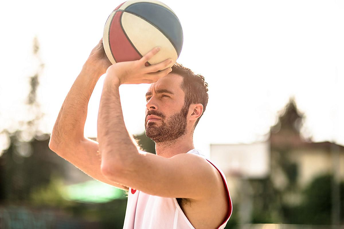 a man holding a frisbee