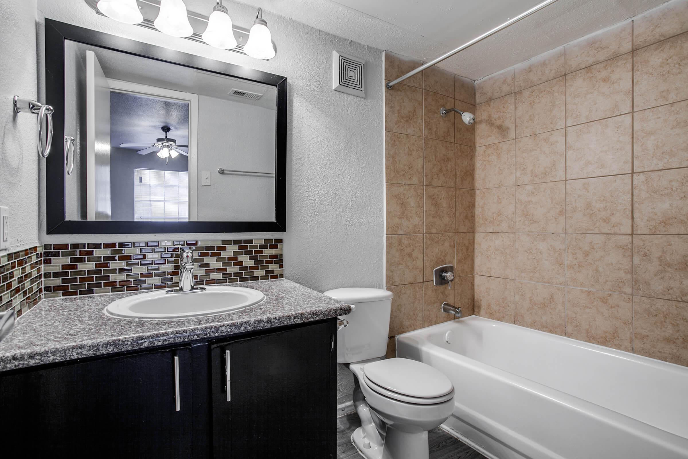 a room with a large tub next to a sink