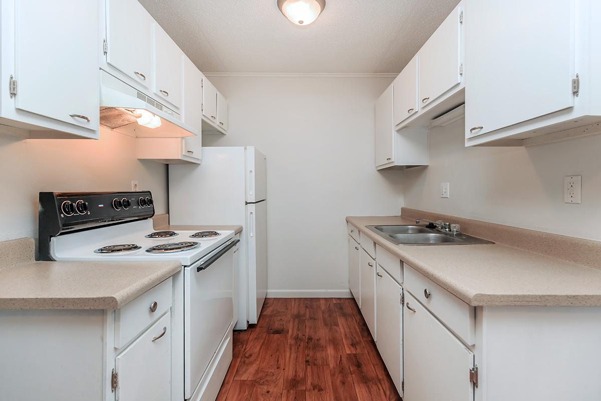 a kitchen with a stove and a sink