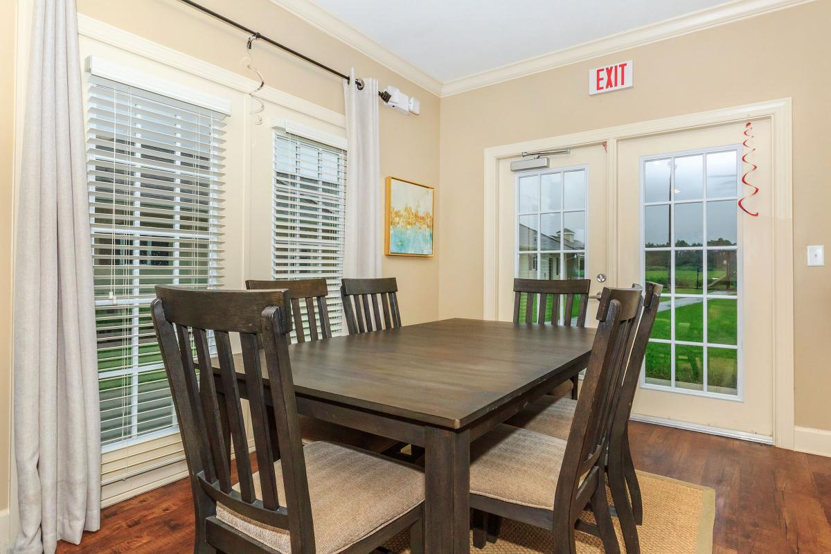 a dining room table in front of a window