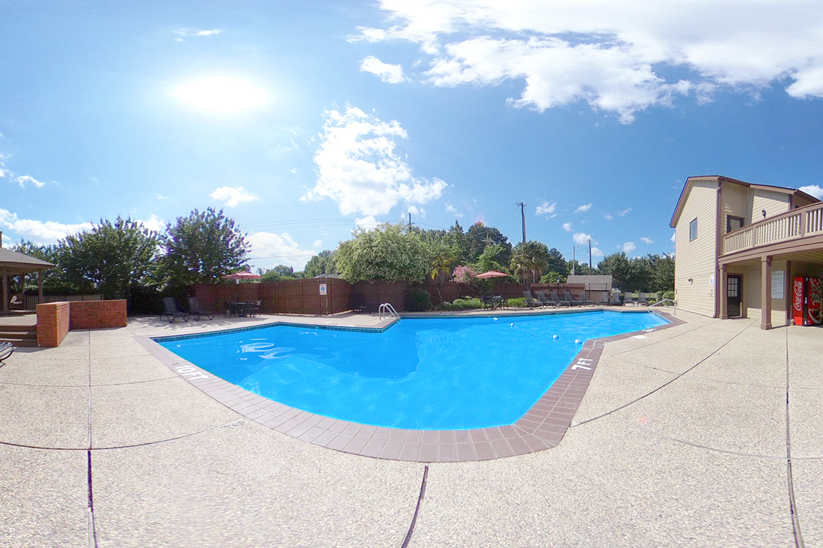 A 360 degree look of the swimming pool and clubhouse at Van Mark Apartments in Monroe, LA